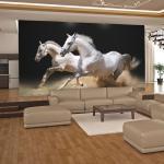 Fototapeta Cválajúce kone v piesku - Galloping horses on the sand